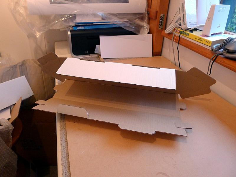 triangular cardboard postal tubes folding