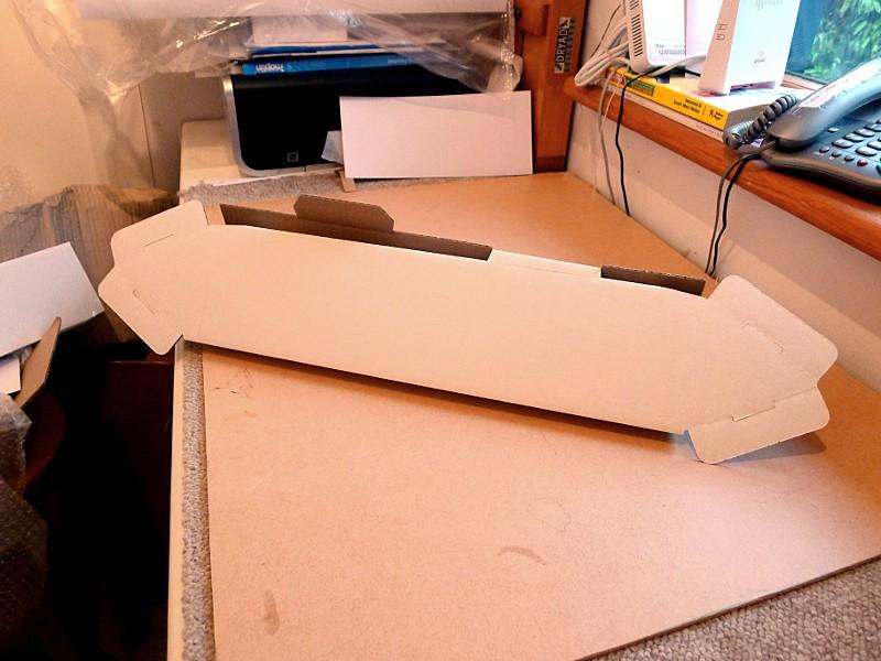 triangular cardboard postal tubes building