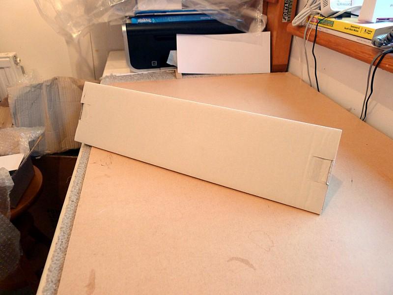 triangular cardboard postal tubes built