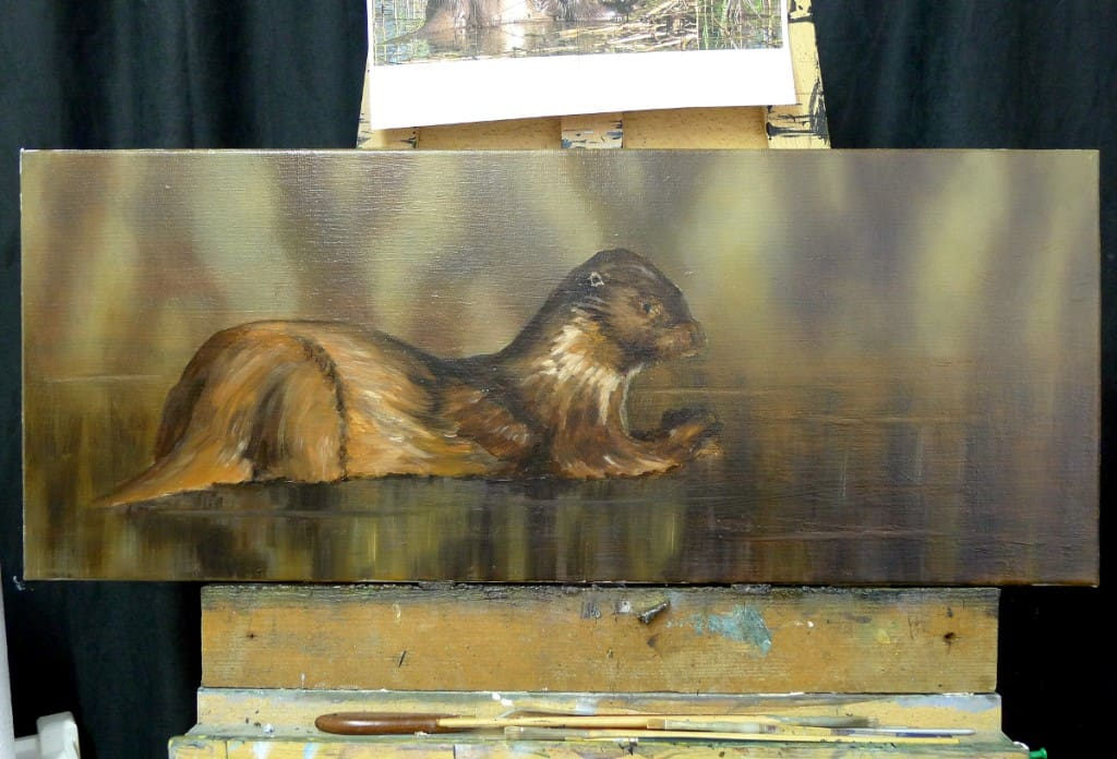 otter painting on artists easel