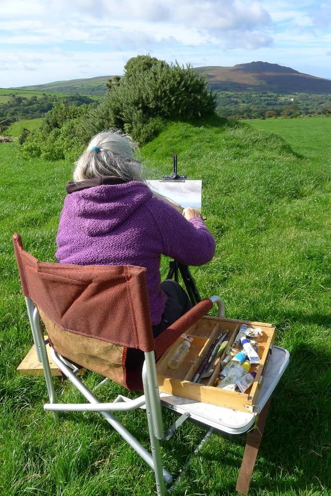 Diane Mathias painting outdoors in Wales
