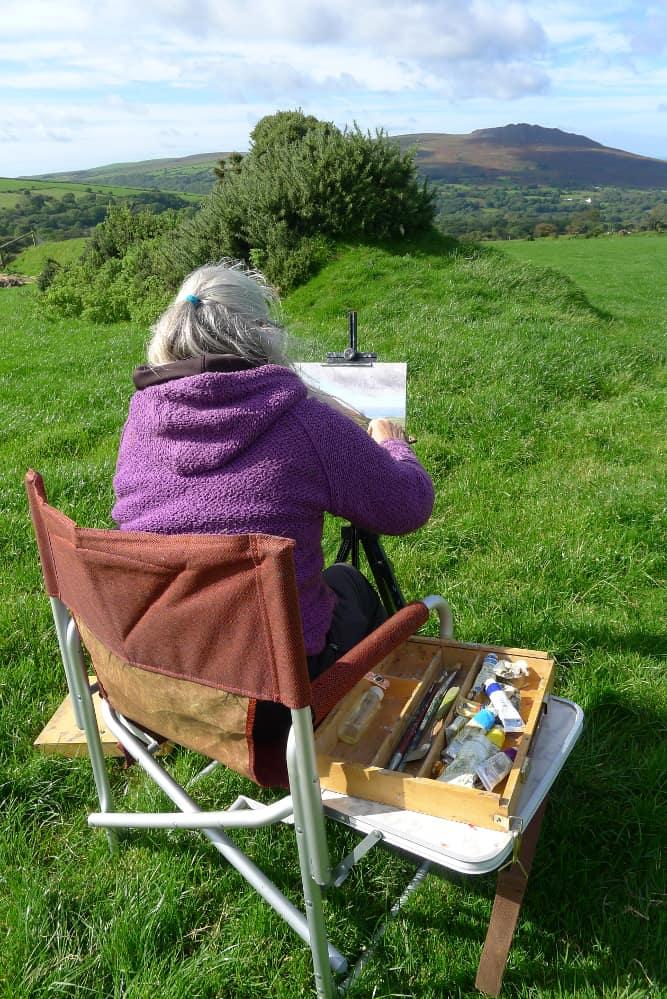 Diane Mathias painting outdoors in Wales