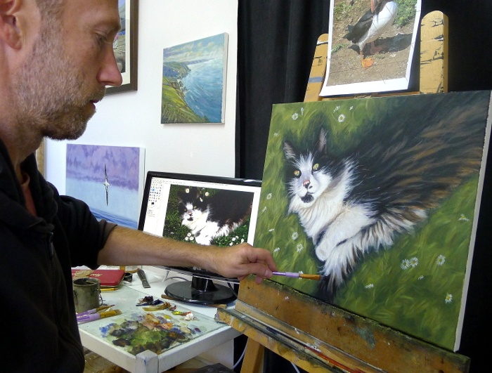 cat portrait painting on the easel