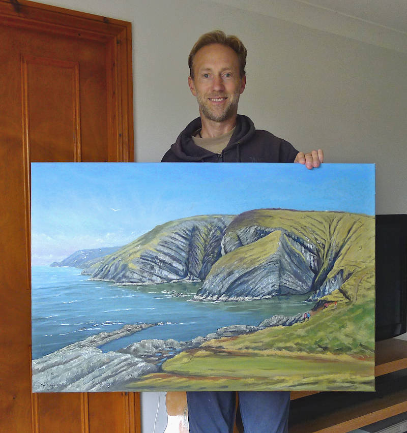 Oil painting of Ceibwr bay hanging on the wall