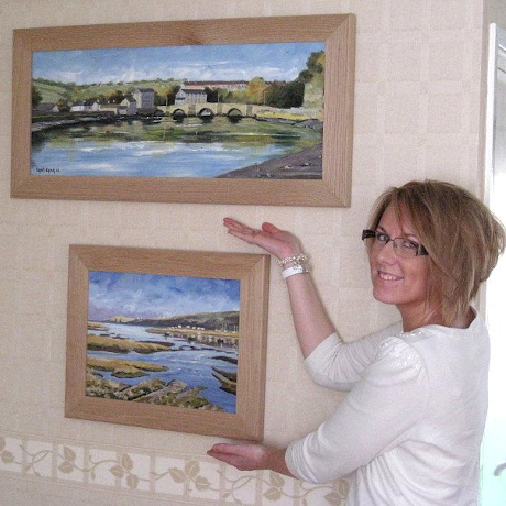 Happy client with her framed paintings