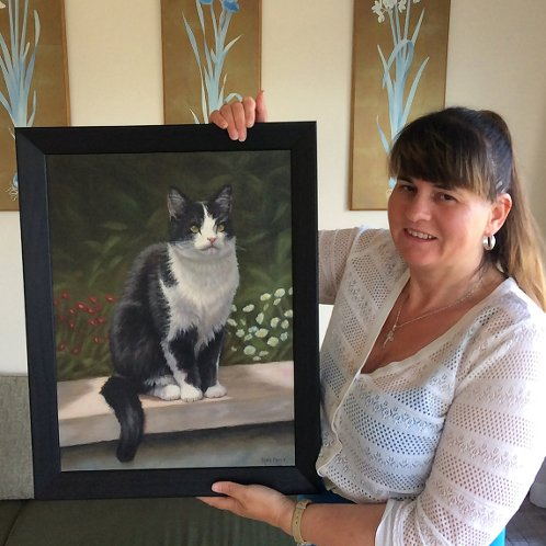 Happy client with their pet portrait