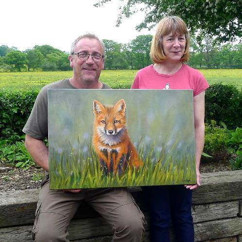 Happy client with their fox painting