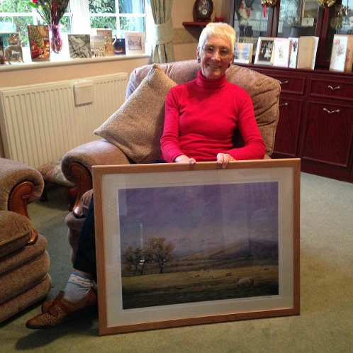 Happy client in Pembrokeshire with their framed print