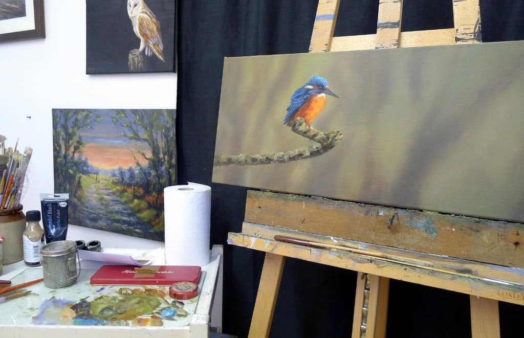 kingfisher painting on artists easel
