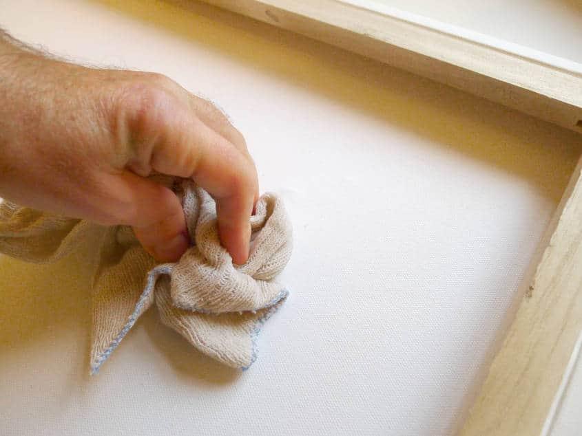 Rub wet rag on painting.